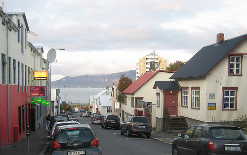 A view down a downtown Reykjavik side street, with its typical metal-clad buildings, leading to the harbor.